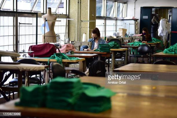 Stagecraft member of Teatro Colon sews face masks on April 23, 2020 in Buenos Aires, Argentina. Stagecraft members of government-run theatres of...