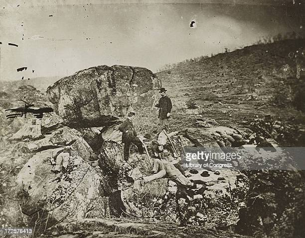 Staged photograph of corpses at Devil's Den, after the Battle of Gettysburg, Pennsylvania, circa 1863.