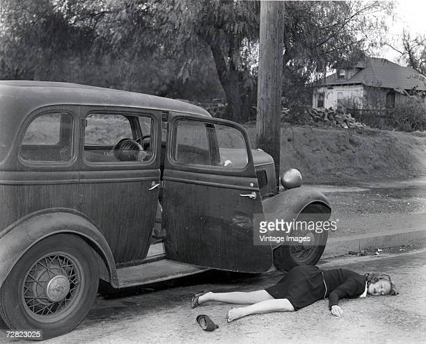 Staged view of the victims of a roadside accident mid 1930s or early 1940s In the view the car appears to have hit a telephone pole causing a female...