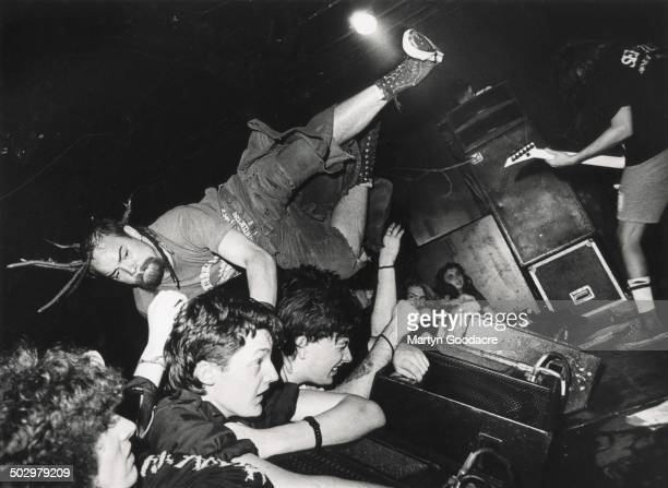 Stagediver at a Napalm Death gig at the ICA London United Kingdom 1990