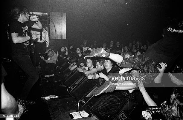 A stagediver jumps into the crowd as Napalm Death perform on stage at the ICA London United Kingdom 1990