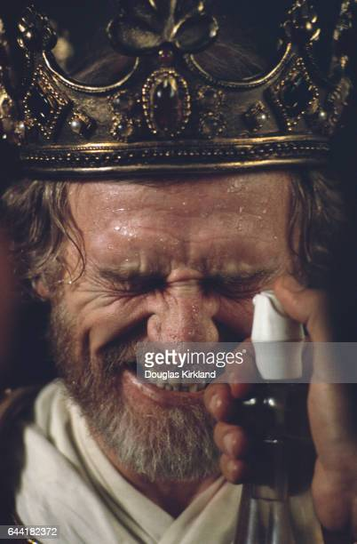 A stagehand mists the face of Richard Harris on the set of Robin and Marian Harris who played the role of King Richard also starred with Sean Connery...