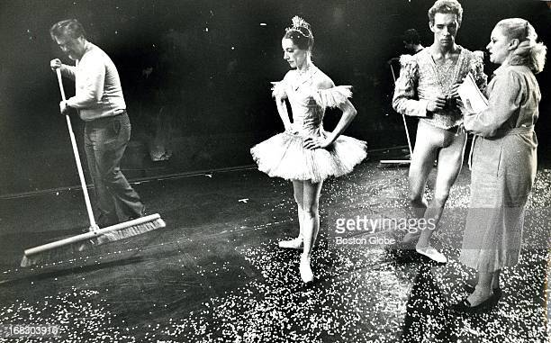 Stagehand Ray McLaughlin swept artificial snow from the stage of Boston's Metropolitan Center for the Performing Arts during dress rehearsal for...