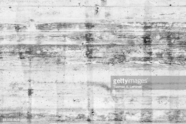 Stained and weathered concrete wall background in black&white.