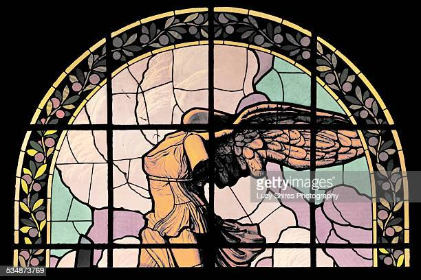 stained glass angel in semi-circle window - lucy shires stock pictures, royalty-free photos & images