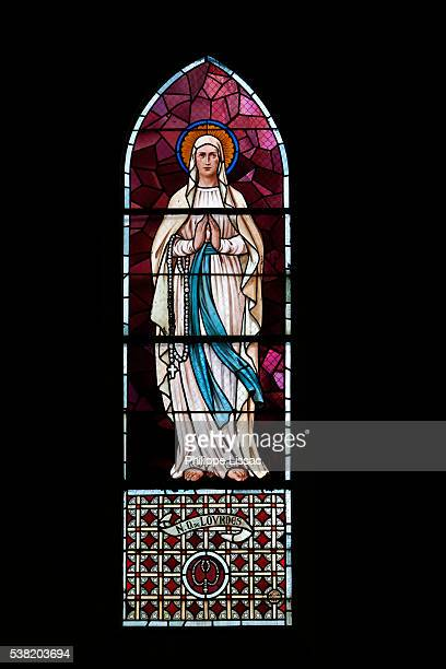 stained glass in a catholic church : our lady of lourdes - our lady of lourdes stock pictures, royalty-free photos & images