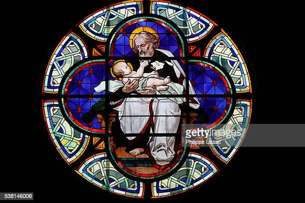 Stained glass in Notre-Dame-du-Rosaire church: Saint Joseph holding Jesus