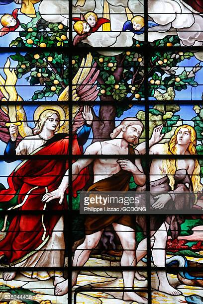 Stained glass in the church of the Saint Sulpice catholic seminary church, Issy-les-Moulineaux. Adam and Eve driven out of Eden.