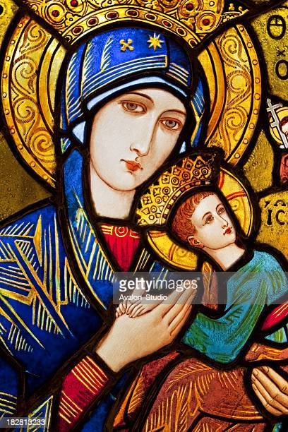stained glass - mary and jesus - manger stock photos and pictures