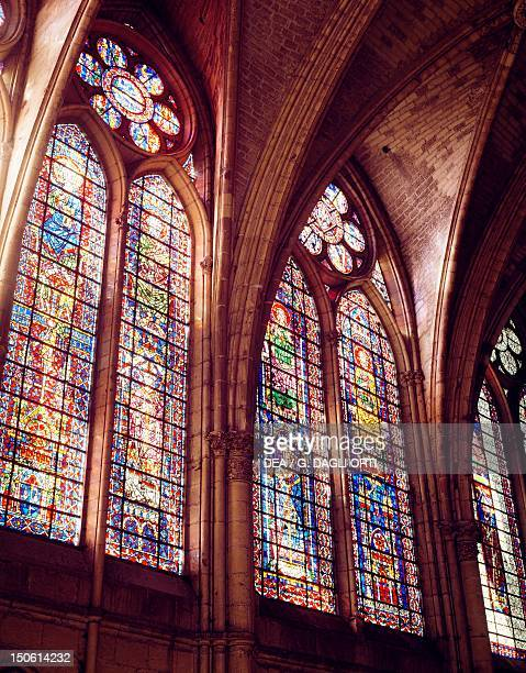 Stained glass of the tall windows of the nave detail of the interior of the Cathedral of NotreDame Reims France 13th century