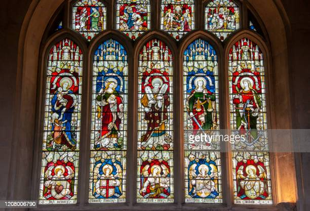 stained glass painting in bath abbey, uk - religious symbol stock pictures, royalty-free photos & images