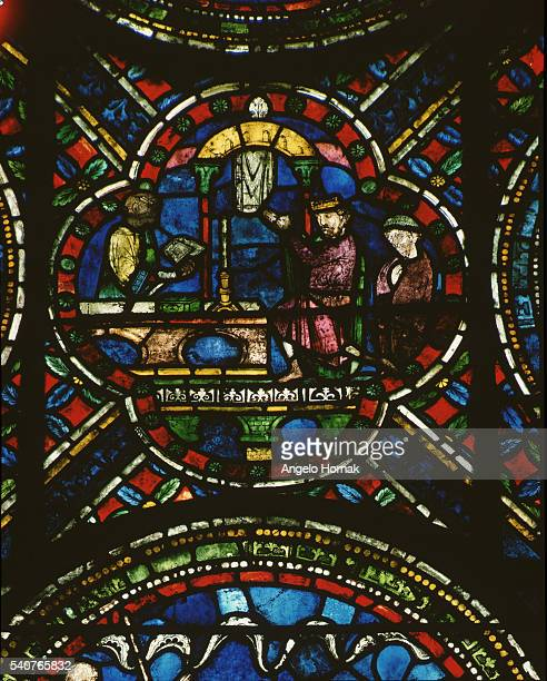 A stained glass panel from around 1220 depicts Henry II doing penance at the tomb of St Thomas A Becket in 1174 Canterbury Cathedral | Location north...