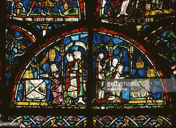 A stained glass panel in the form of a lunette depicts pilgrims at the shrine of Saint Thomas Becket after 1220 Canterbury Cathedral | Location south...