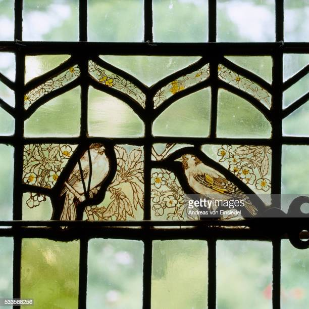 stained glass panel of birds by aymer vallance (1863-1943) in a side window in the solar at stoneacr - 1943 stock pictures, royalty-free photos & images