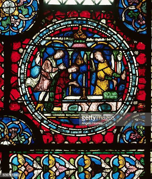 A stained glass roundel panel depicts pilgrims at the shrine of Saint Thomas Becket after 1220 Canterbury Cathedral | Location south choir aisle...