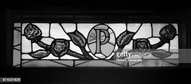 A stained glass transom window over the front door of singer Elvis Presley's former home in Memphis Tennessee features the letter P flanked with...