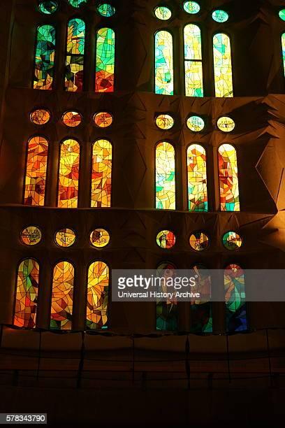 Stained glass window at the Basalica i Temple Expiatori de la Sagrada Familia, a Roman Catholic church in Barcelona, designed by Spanish architect...