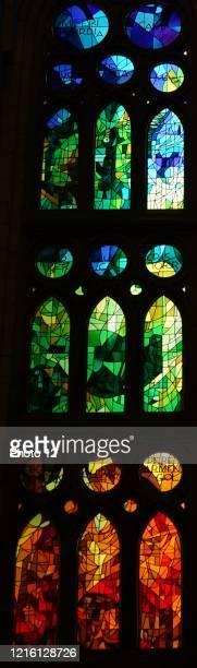 Stained glass window at the Basilica i Temple Expiatori de la Sagrada Familia, a Roman Catholic church in Barcelona, designed by Spanish architect...