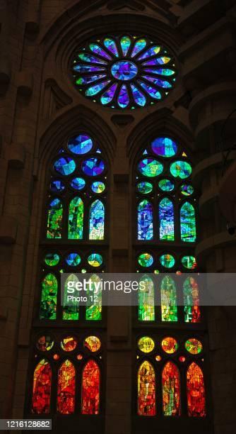 Stained glass window at the Basilica I Temple Expiatory de la Sagrada Familia, a Roman Catholic church in Barcelona, designed by Spanish architect...