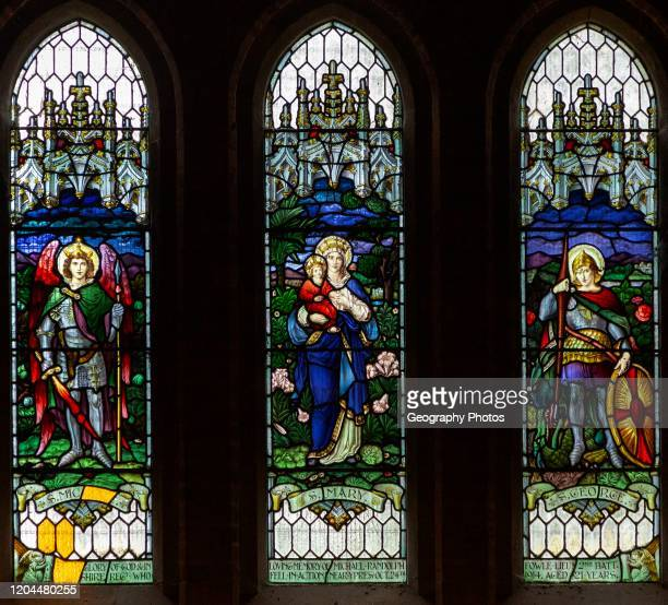 Stained glass window, Chute church, Wiltshire, England, UK Saints Michael, Mary and George.