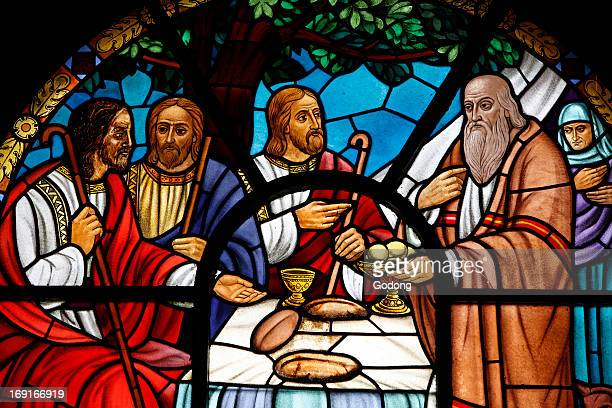 Stained glass window depicting a biblical scene from Genesis in Holy Trinity Cathedral Abraham meeting the Holy Trinity in Mamre