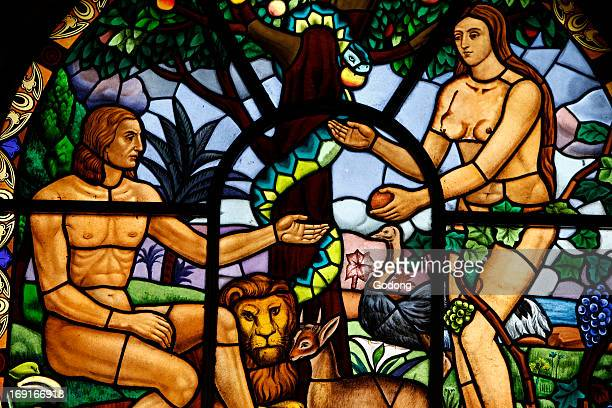 Stained glass window depicting Adam and Eve in the Garden of Eden Holy Trinity Cathedral