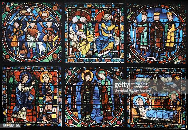 Stained glass window from above the main entrance to Chartres Cathedral France Shows the life of Christ Annunciation Visitation Birth Shepherds King...