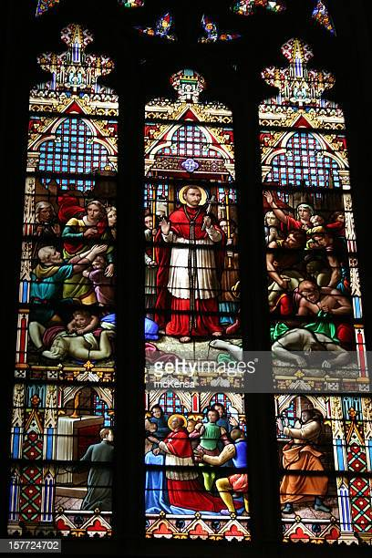 stained glass window in st patrick's cathedral, new york - st. patricks cathedral manhattan stock photos and pictures