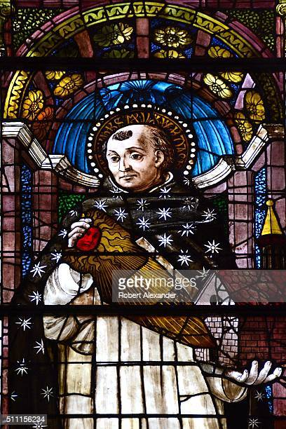 A stained glass window in the Cappella Strozzi di Mantova in Santa Maria Novella church in Florence Italy depicts Saint Thomas Aquinas Photo by...
