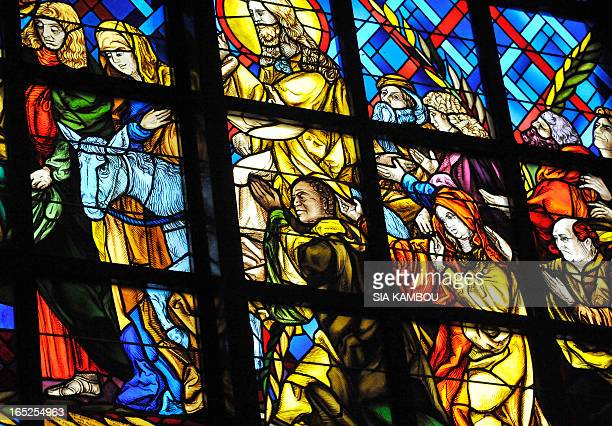 A stained glass window in the 'Notre Dame de la Paix' Basilica in Yamoussourkro Ivory Coast depicts the first Ivorian president Felix Houphouet...