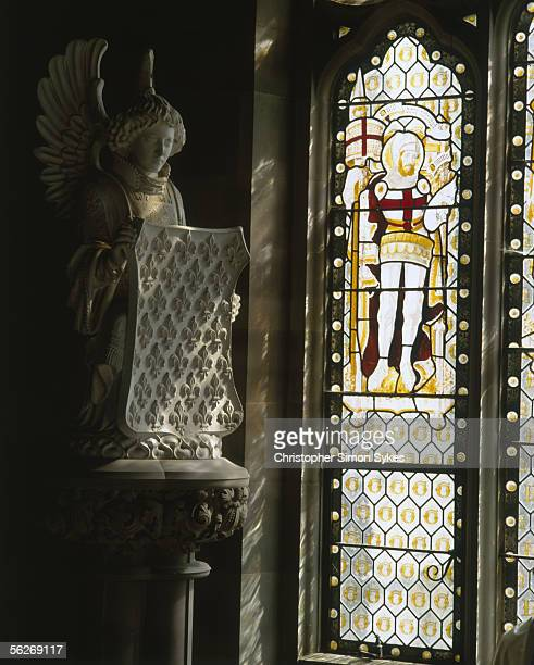 A stained glass window in the Outer Hall of Carlton Towers Yorkshire 1990s The room was designed as a temporary chapel in 1876 hence the religous...
