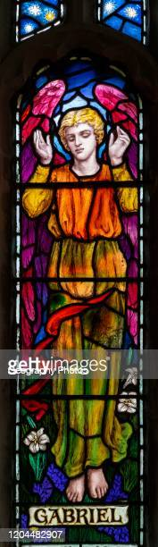 Stained glass window of Angel Gabriel, Great Cheverell, Wiltshire, England, UK Mary Lowndes 1920.