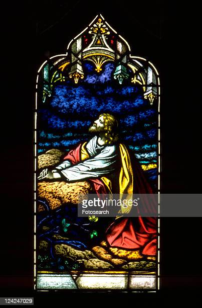 stained glass window of jesus praying in the garden of gethsemane - garden of gethsemane stock pictures, royalty-free photos & images
