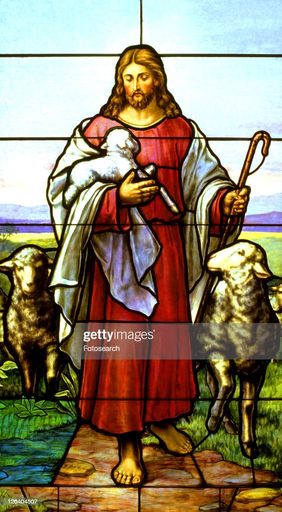 Stained Glass Window Of Jesus The Good Shepherd Carrying A Lamb Stock Photo