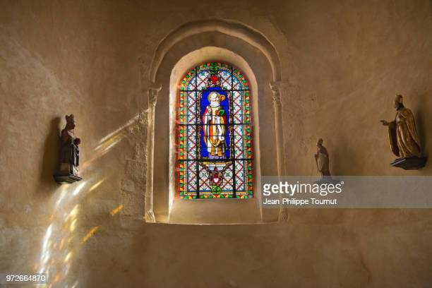 stained glass window of saint martial, monastery of st. valerie in chambon sur voueize, abbatiale sainte valérie, creuse, france - chapel stock pictures, royalty-free photos & images