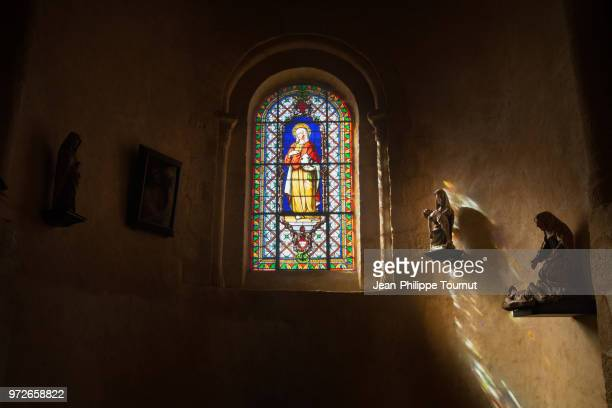 stained glass window of saint mary magdalene in a chapel of the the church saint valerie in chambon sur voueize, creuse, france - abadia igreja - fotografias e filmes do acervo