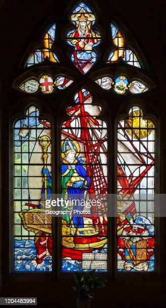 Stained glass window of Saint Nicholas standing in ship by Martin Travers 1927 Cricklade church, Wiltshire, England, UK.