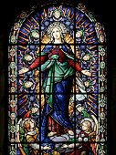 A stained glass window of Santa Maria