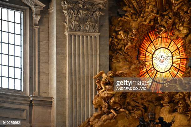 A stained glass window of the apse of St Peter's basilica figures a dove the symbol of the Holy Spirit on March 30 2018 before the Celebration of the...