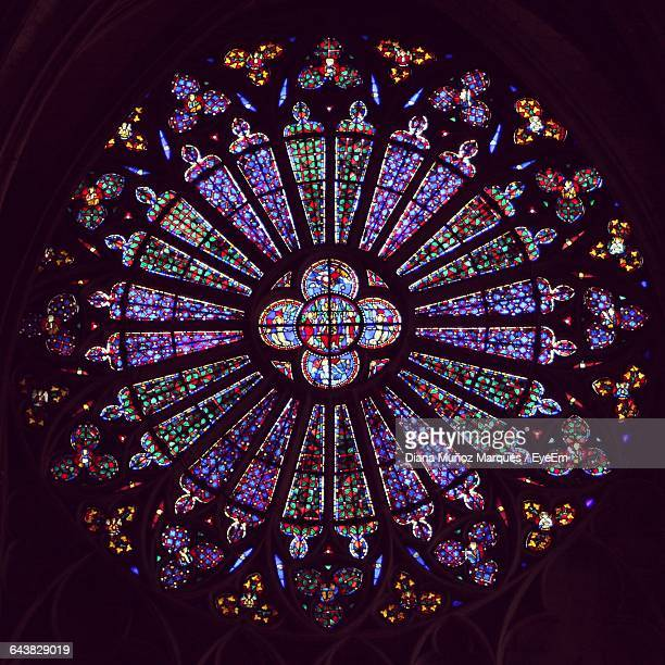 stained glass window pattern in dark at church - stained glass stock photos and pictures