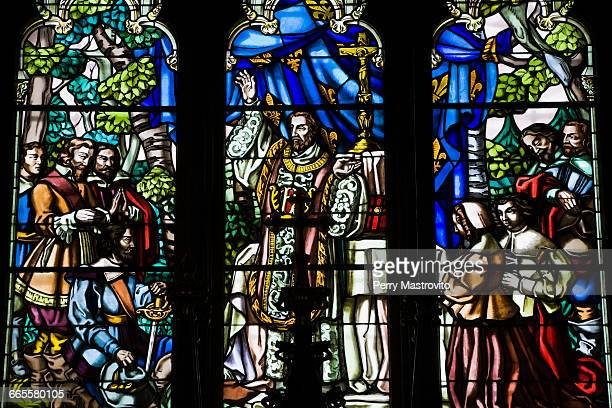 stained glass window - notre dame de montreal stock photos and pictures