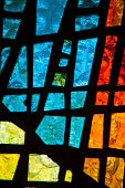 Stained glass window with geometric patterns of glass
