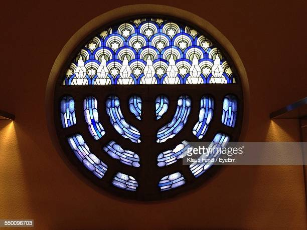 stained glass window with menorah design - synagogue stock pictures, royalty-free photos & images