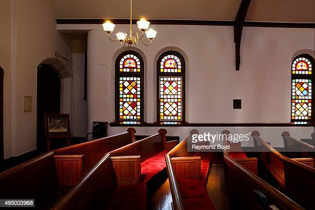 Stained glass windows and pews inside Greenstone United Methodist Church photographed during the Chicago Architecture Foundation's 'Open House...