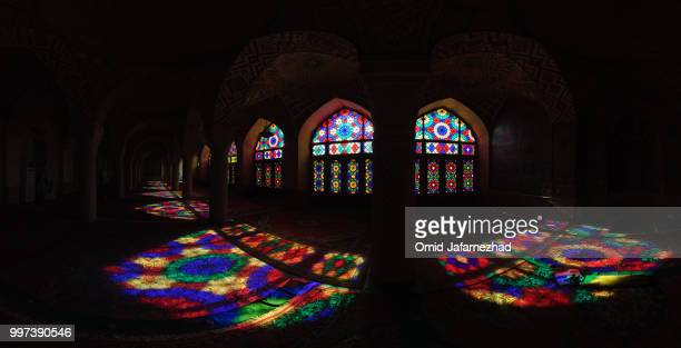 stained glass windows in a monastery. - klooster stockfoto's en -beelden