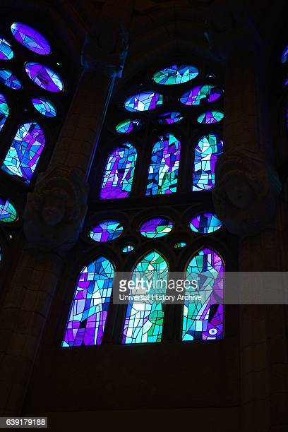 Stained glass windows inside the Sagrada Familia, Catholic church in Barcelona, designed by Spanish architect Antoni Gaudi .