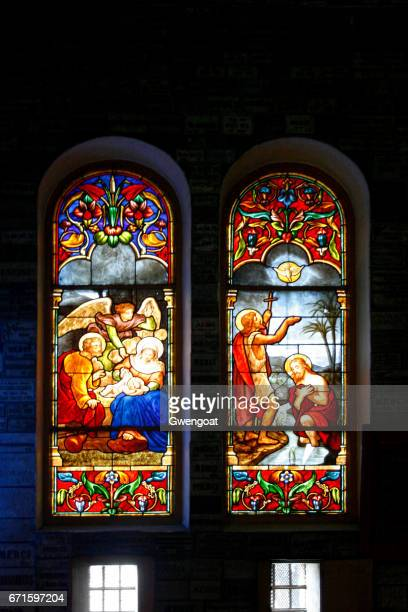 stained glasses of the notre-dame cathedral basilica of saigon - archangel michael stock photos and pictures