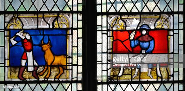 Stainedglass window of the Saint Claude Chapel in Collegiate Church of NotreDame de SemurenAuxois Stainedglass window called Window of the butchers...