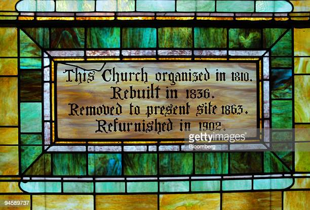 A stainedglass window shows the date the Sag Harbor Methodist Church was moved to Madison Street in Sag Harbor Long Island New York US on Tuesday...