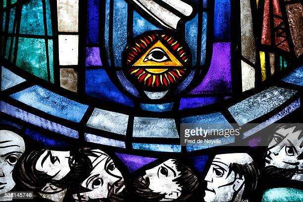 stained-glass window. the eye of providence, emphasizing the triangle representing the trinity. - holy trinity stock pictures, royalty-free photos & images